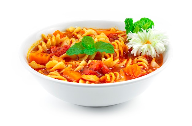 Pasta with tomato soup italian food fusion style decoration carved leek and vegetables