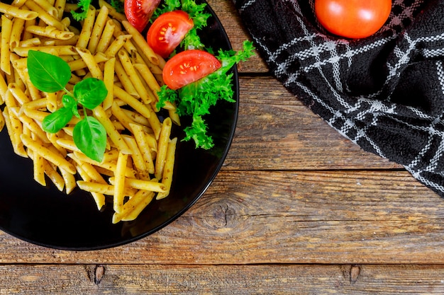 Pasta with tomatoes and basil leaves