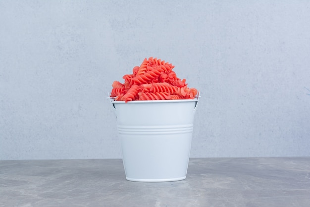 Pastas isolated in a colorful metallic bucket