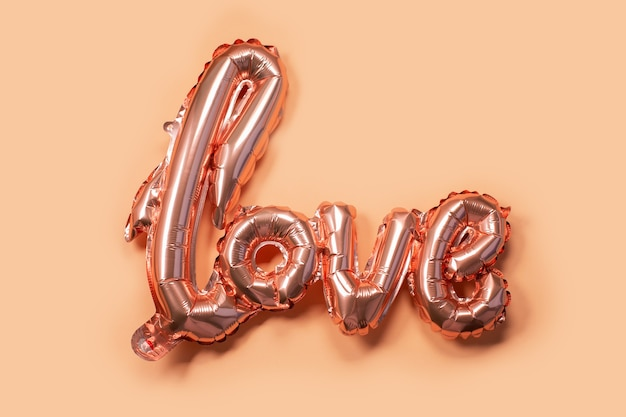 Pastel beige air balloon in the shape of the word love
