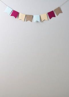 Pastel bunting paper cut on pastel bunting paper cut on bright gray wall backgroun