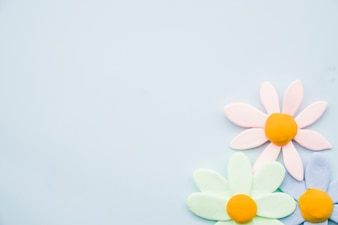 Pastel clay flowers on gray background