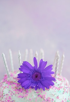 Pastel color birthday cake with flower