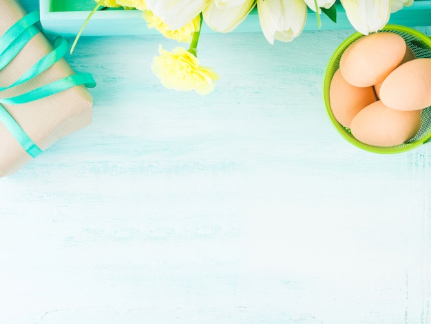 Pastel color easter eggs gift flowers. top view