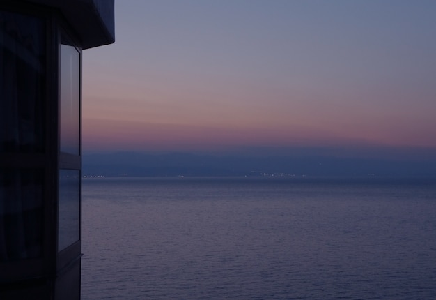 Pastel color gradation of the evening sky over the adriatic sea, view from terrace, opatija, croatia