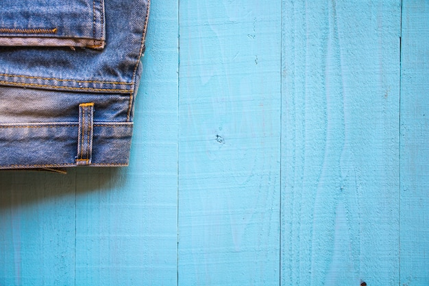 Pastel color, vintage style ,jeans on wood background.soft and blur.