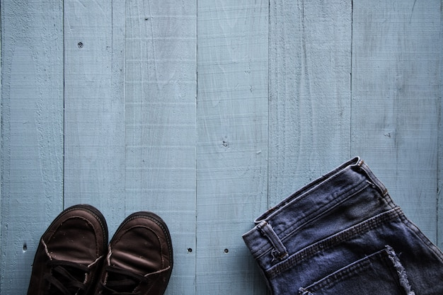 Pastel color, vintage style, shoes, jeans on wood background