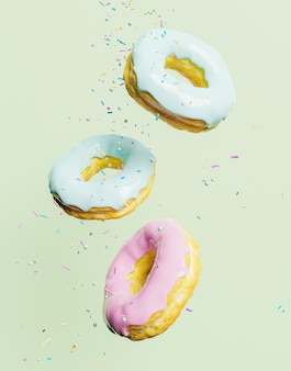 Pastel colored chocolate donuts with confetti falling on them and a green wall