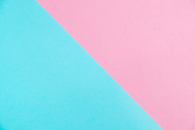Pastel colored paper flat lay top view, background texture, pink and blue.