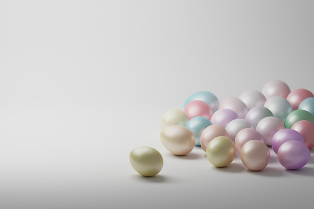Pastel colored shiny easter eggs on white surface