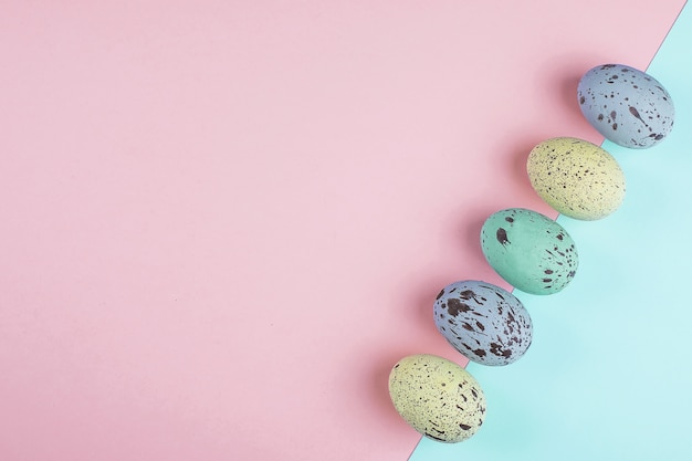 Pastel colorful easter eggs on trendy paper background. flat lay, top view, copy space