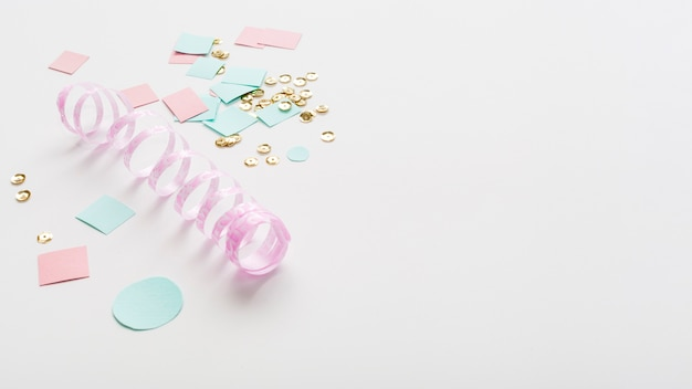 Pastel-coloured ribbon with paper and copy space