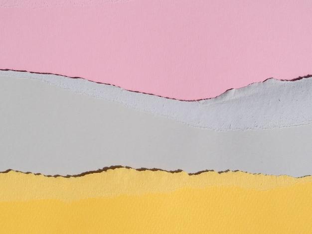 破れた抽象的な紙の行のパステルカラー