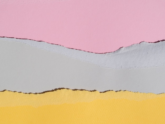 Pastel colours of ripped abstract paper lines