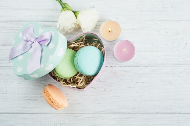 Pastel green gift box and macaroons
