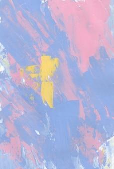 Пастель гранж-фон, мазки кистью синий, розовый, желтый, белый на бумаге