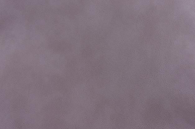 パステルラベンダーの質感の滑らかな革の表面の背景、小さな穀物
