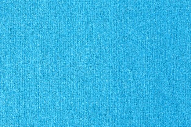 パステルライトブルーの色調の水彩紙の質感。マクロ写真。