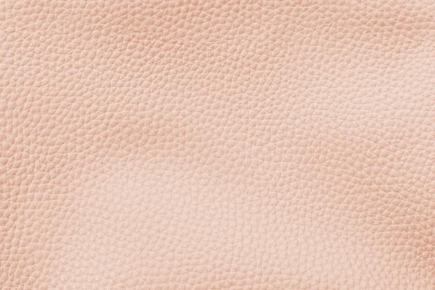 Pastel orange artificial leather textured background