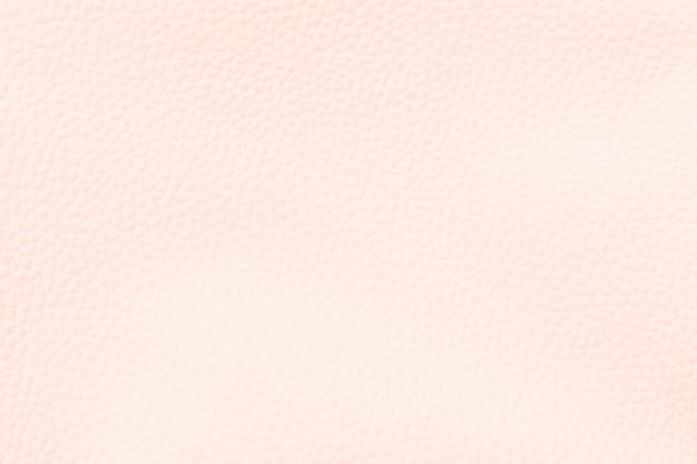 パステルオレンジの人工皮革の織り目加工の背景