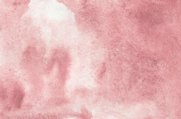 テクスチャードペーパー上のパステルピンクの抽象的な水彩画の背景