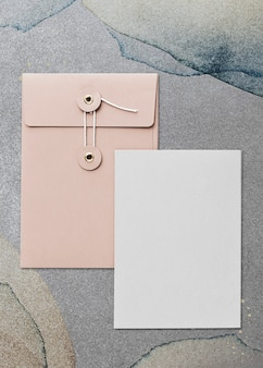 Pastel pink envelope card design in gray background
