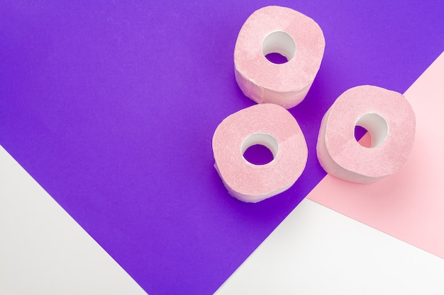 Pastel pink toilet paper with copyspace