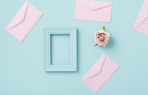 Pastel space envelope with picture frame and rose flower