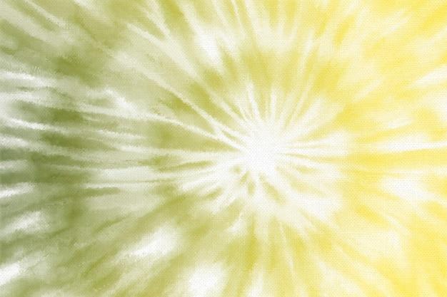 黄色の背景にパステル渦巻きタイ染料