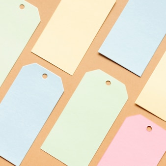 Pastel tags on neutral carboard sheet