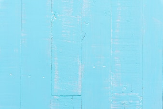 Pastel white and blue wooden table background texture.