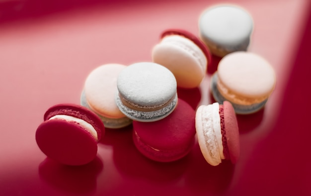 Pastry bakery and branding concept  french macaroons on wine red background parisian chic cafe desse...
