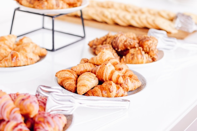 Pastry cookies and croissants sweet desserts served at charity event  food drinks and menu concept as holiday background banner for luxury brand design