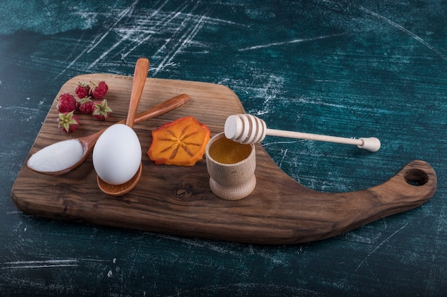Pastry ingredients on a wooden platter