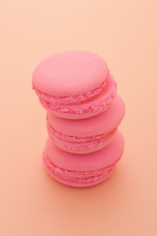 Pastry pink round shape on a pink background