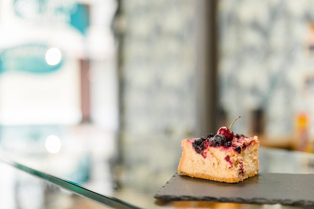 Pastry on shale board over glass counter