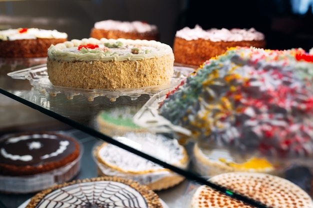 Pastry shop glass display with selection of cakes