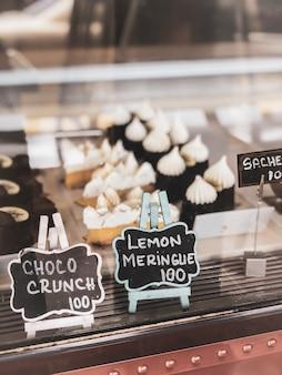 Pastry shop with variety dessert of choco crunch, lemon meringue