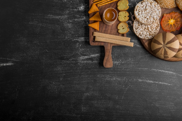 Pastry and snack varieties on wooden platters