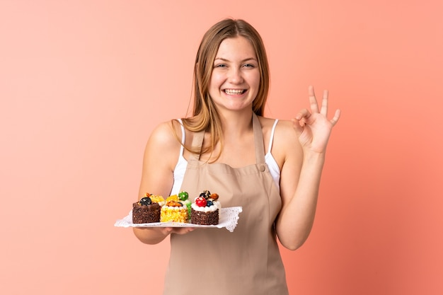 Pastry ukrainian chef holding a muffins