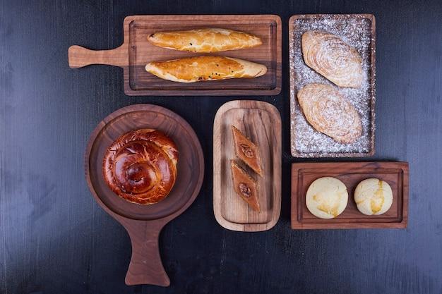 Pastry varieties on wooden platters,  top view