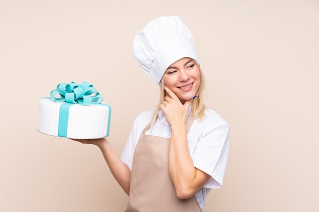 Pastry woman holding a cake