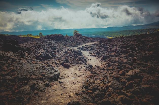 Path among the volcanic rocks of mount etna. sicily.