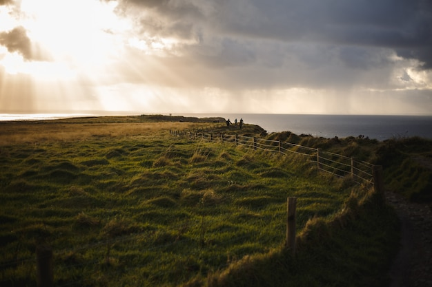 Path of cliffs of moher with cloudscape and sunshine