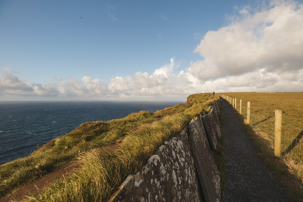 Path of cliffs of moher with cloudscape
