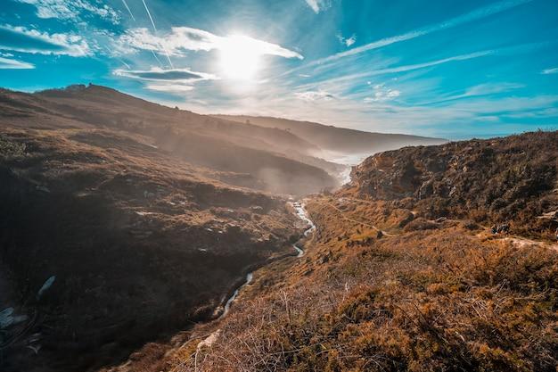 A path of the mountain of jaizkibel with the sun  near san sebastian, gipuzkoa. spain