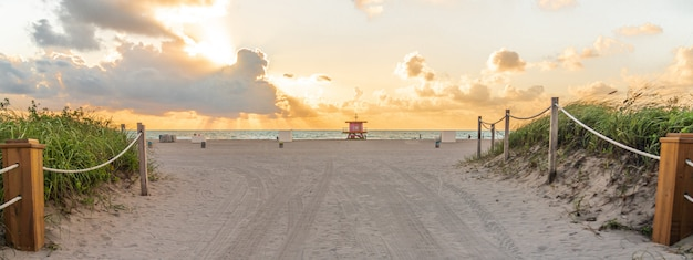 Pathway to the beach in miami beach florida with ocean  at sunrise