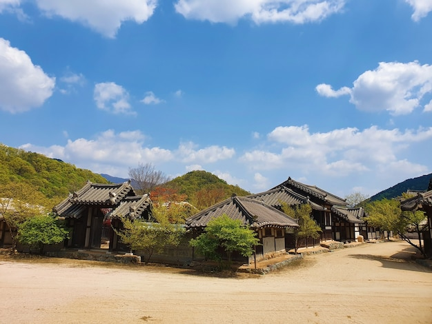 Pathway in the middle of korean village buildings under a blue sky