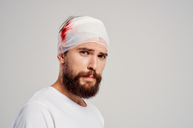 Patient bandaged head and hand blood treatment