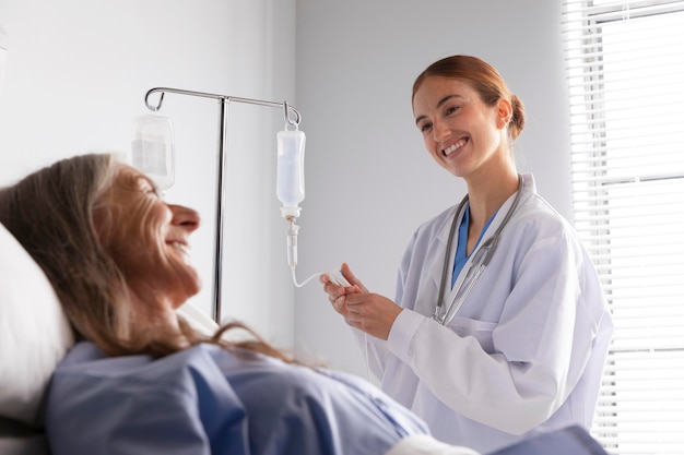 Patient in bed talking to the doctor